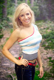 Beautiful blond woman on a forest road Stock Photos