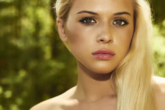 Beautiful blond woman in forest. summer sunlight Stock Photography