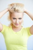 Beautiful blond woman frowning at the camera Royalty Free Stock Photo
