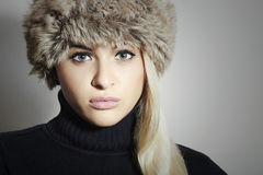 Beautiful Blond Woman in Fur Hat. Beauty Fashion Girl. Winter Style Royalty Free Stock Photography