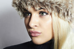Beautiful Blond Woman in Fur Hat. Beauty Fashion Girl. Winter Style Royalty Free Stock Photo