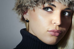Beautiful Blond Woman in Fur Hat. Beauty Fashion Girl. Winter Style Royalty Free Stock Image