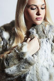 Beautiful blond woman in fur.winter fashion.Beauty blond Model Girl in Rabbit Fur Royalty Free Stock Photography