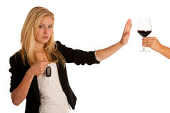 Beautiful blond woman gesturing don't drink and drive gesture, w Royalty Free Stock Image