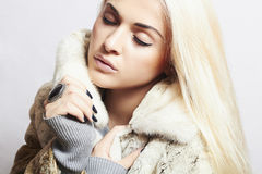 Beautiful blond woman Girl in Mink Fur Coat.winter fashion Stock Photography
