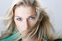 Beautiful blond woman giving an assessing look Royalty Free Stock Photo