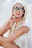 Beautiful blond woman in glasses Royalty Free Stock Photos