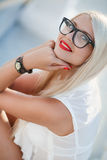 Beautiful blond woman in glasses royalty free stock image
