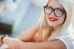 Beautiful blond woman in glasses Royalty Free Stock Images