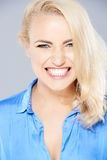 Beautiful blond woman gnashing her teeth Stock Image
