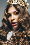 Beautiful blond woman in golden crown Royalty Free Stock Photos