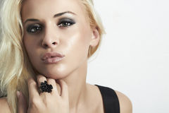 Beautiful blond woman with green eyes. beauty girl. ring. Beautiful blond woman with green eyes. beauty girl. black ring Stock Photos