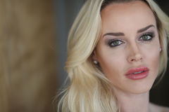 Beautiful Blond Woman with Green Eyes Royalty Free Stock Image