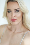 Beautiful Blond Woman with Green Eyes Stock Photography