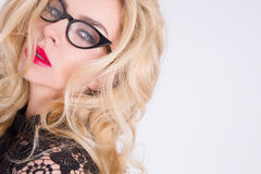 Beautiful blond woman green eyes of sweet red lips and glasses Royalty Free Stock Photography