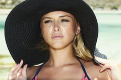 Beautiful blond woman in hat.paradise island Royalty Free Stock Photography