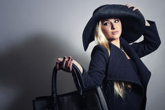 Beautiful Blond Woman in Hat.Shopping with Handbag Royalty Free Stock Photography
