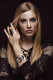 Beautiful blond woman with healthy skin and hair, red manicure, posing in studio. Beauty face. Royalty Free Stock Photography