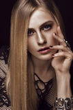 Beautiful blond woman with healthy skin and hair, red manicure, posing in studio. Beauty face. Stock Photos