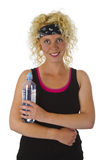 Beautiful blond woman holding bottle of water Stock Image