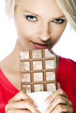 Beautiful blond woman holding a chocolate Stock Photography