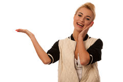 Beautiful blond woman holding hand over white copy space foro pr Stock Photography