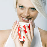 Beautiful blond woman holding a mug Stock Photo