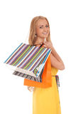 Beautiful blond woman holding shopping bags Stock Photos
