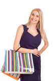 Beautiful blond woman holding shopping bags Royalty Free Stock Images