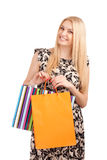 Beautiful blond woman holding shopping bags Royalty Free Stock Photos
