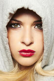 Beautiful blond woman in hood. red lips. Portrait of beautiful blond woman in hood. red lips Royalty Free Stock Image