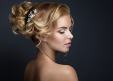 Beautiful blond woman in image of the bride Stock Images