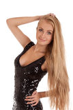 Beautiful Blond Woman In Black Shiny Dress Royalty Free Stock Photo