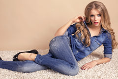 Beautiful blond woman in jeans clothes Stock Photo