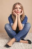 Beautiful blond woman in jeans clothes Stock Images