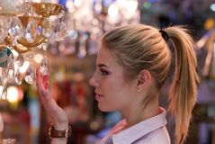 Beautiful blond woman in lamp shop Royalty Free Stock Photos