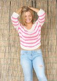 Beautiful blond woman laughing with hands in hair Royalty Free Stock Photography