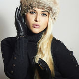 Beautiful Blond Woman in Leather Gloves.Beauty Girl in Fur Cap Royalty Free Stock Photography