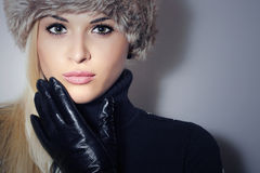 Beautiful Blond Woman in Leather Gloves.Beauty Girl in Fur Cap Stock Photography
