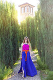 Beautiful blond woman in long colorful dress outdoors Royalty Free Stock Image