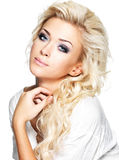 Beautiful blond woman with long curly hair and style makeup. Royalty Free Stock Photography