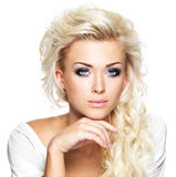 Beautiful blond woman with long curly hair and style makeup. Stock Image