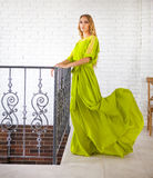Beautiful blond woman in long dress Royalty Free Stock Photo