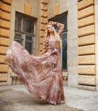 Beautiful blond woman in long dress outdoors Stock Photo
