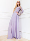 Beautiful blond woman in long lavender dress Stock Image