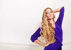 Beautiful blond woman in long violet dress Royalty Free Stock Images
