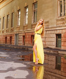 Beautiful blond woman in long yellow dress outdoors Royalty Free Stock Images
