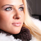 Beautiful blond woman that looks somewhere. Close-up portrait of beautiful blond woman that looks somewhere Royalty Free Stock Images