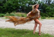 Beautiful blond woman in luxury animal print resort dress. Fashion outdoor photo of beautiful blond woman in luxury animal print resort dress stock images