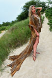 Beautiful blond woman in luxury animal print resort dress Royalty Free Stock Photography